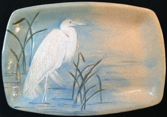 Ceramic platter, sgraffito carved great egret design