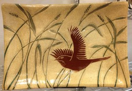 Stoneware platter, sgraffito carved wren and grasses motif