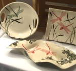 Display of dragonfly-themed tableware