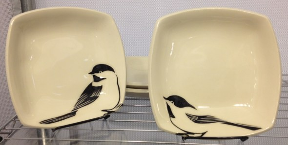 Two stoneware bowls with sgraffito carved chickadee designs