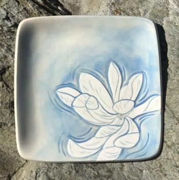 Square stoneware plate, sgraffito carved magnolia motif