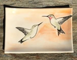 Stoneware platter, sgraffito carved hummingbirds motif