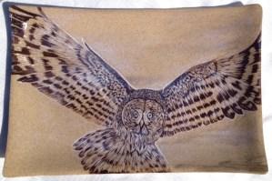 Stoneware platter, sgraffito carved owl design
