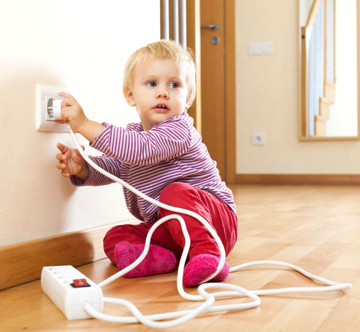 toddle playing with outlet