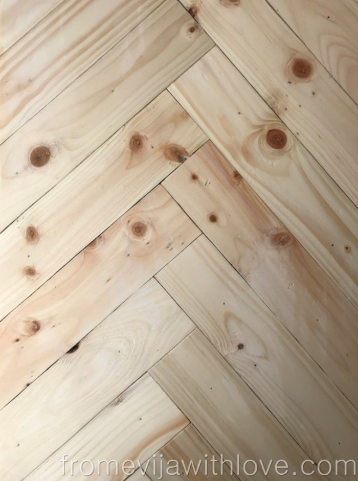 sanded and smooth palletwood in herringbone pattern