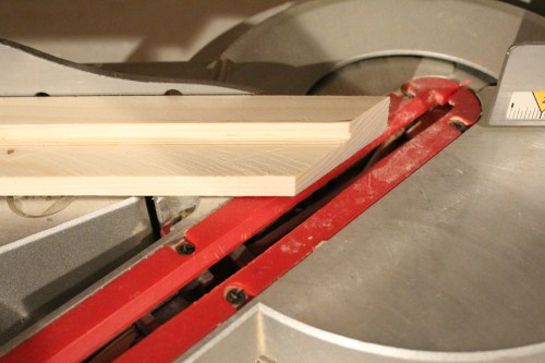 Cutting the edges of the wood at a 45 degree angle for the sign