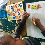 Working on name writinng skills thanks to supply donations from an Orlando, FL teacher!