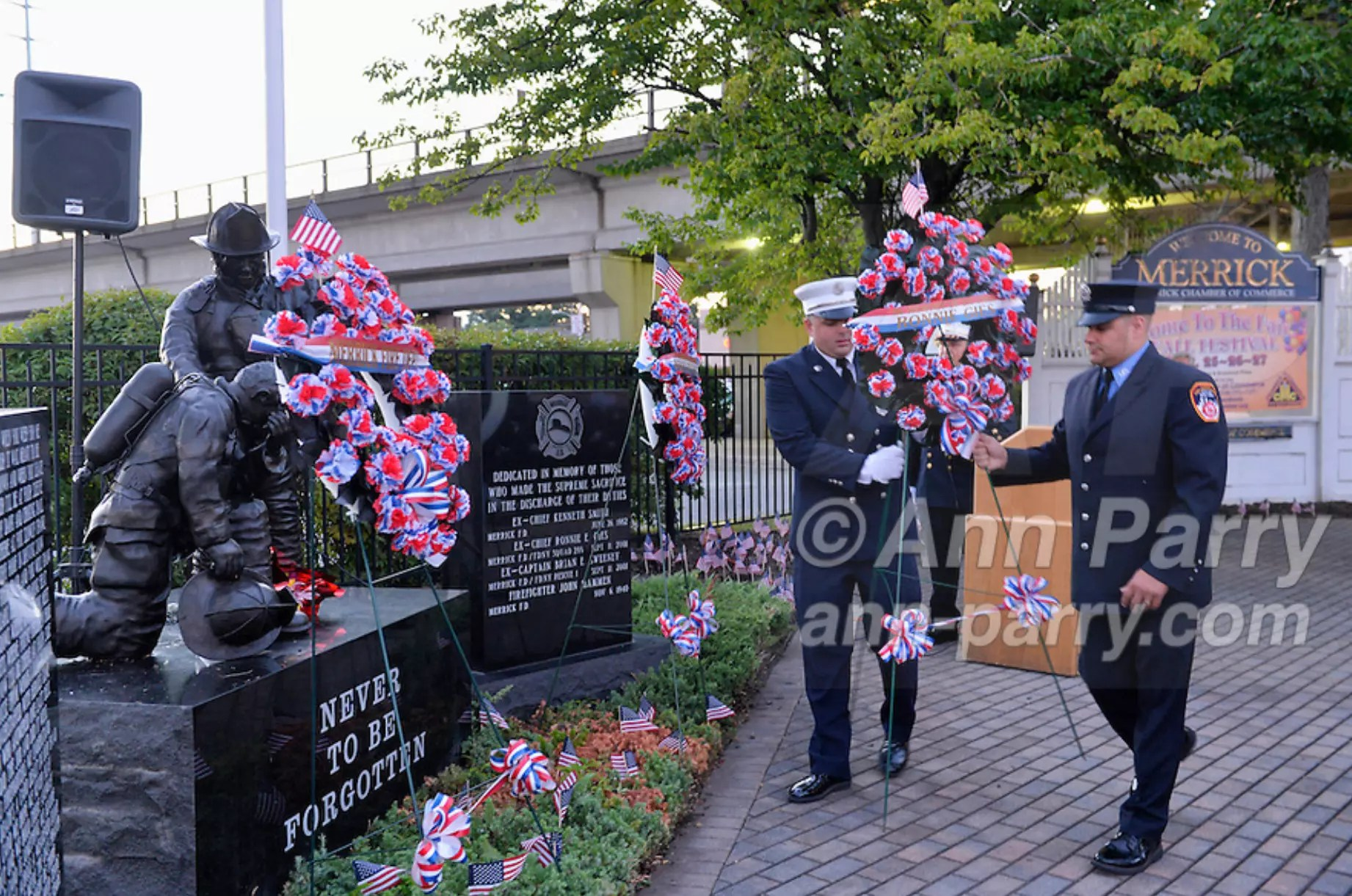 Merrick, NY, USA. Sept. 11, 2015. Merrick and NYC firefighters place a wreath in memory of Ex-Chief Ronnie E. Gies at Merrick Memorial Ceremony for Merrick volunteer firefighters and residents who died due to 9/11 terrorist attack at NYC Twin Towers. Gies, of Merrick F.D. and FDNY Squad 288, and Ex-Captain Brian E. Sweeney, of Merrick F.D. and FDNY Rescue 1, died responding to the attacks on September 11, 2001.
