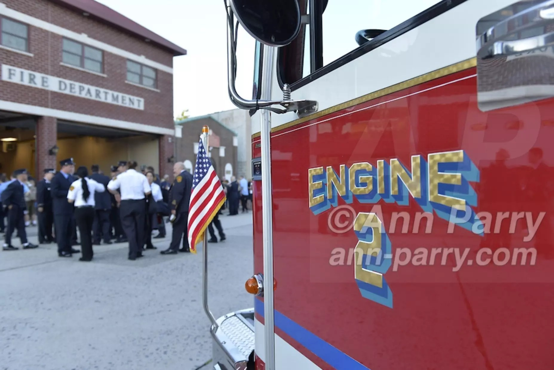 Bellmore, NY, USA. Sept. 11, 2015. A Bellmore fire engine is parked in front of the Bellmore Memorial Ceremony for 3 Bellmore volunteer firefighters and 7 residents who died due to 9/11 terrorist attack at NYC Twin Towers. Bellmore volunteer firefighters Lt. Kevin Prior and F.F. Adam Rand died on 9/11/2001, and F.F. Sean McCarthy died in 2008 due to illness related to working at scene of attack.