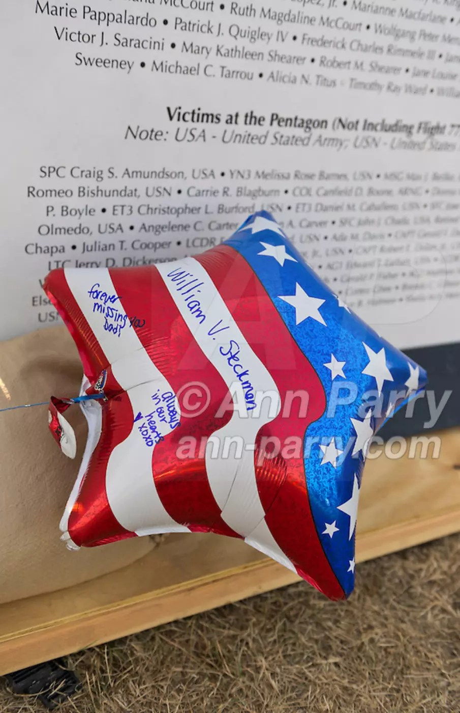 "East Meadow, NY, U.S. 11th Sept. 2013. Red, white, & blue balloon has messages written on it to William V. Steckman (Pop-Pop) of West Hempstead, who worked for NBC in North Tower of Twin Towers, and died 9/11 2001. The Global War on Terror ""Wall of Remembrance"" a traveling memorial on display in New York for the first time, was at Eisenhower Park on the 12th Anniversary of the terrorist attacks of 9/11."