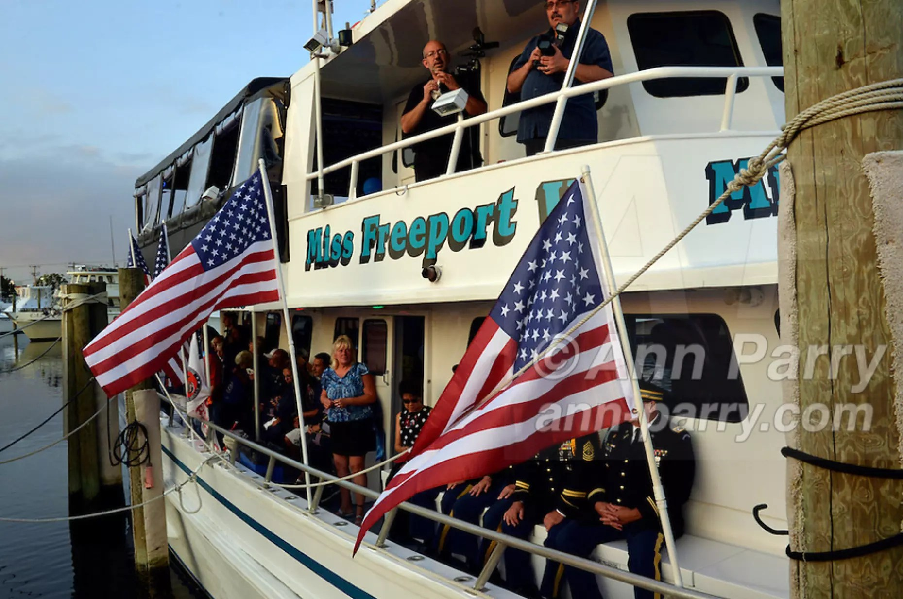 Freeport, NY, USA. 10th Sept. 2014. After a dockside remembrance ceremony in honor of victims of the terrorist attacks of September 11 2001, on Freeport's Nautical Mile, further ceremonies were held on board the boat Miss Freeport V, which sailed from the Woodcleft Canal on the South Shore of Long Island, on the eve of the 13th Anniversary of the 9/11 attacks.