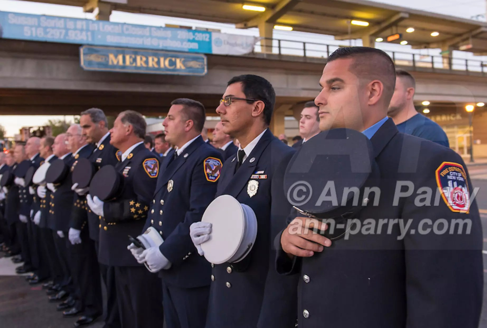 Merrick, NY, USA. 11th Sep.2015. Firefighters from Merrick & NYC stand in line and hold their caps over their hearts during Merrick Memorial Ceremony for Merrick volunteer firefighters and residents who died due to 9/11 terrorist attack at NYC Twin Towers. Ex-Chief Ronnie E. Gies, of Merrick F.D. and FDNY Squad 288, and Ex-Captain Brian E. Sweeney, of Merrick F.D. and FDNY Rescue 1, died responding to the attacks on September 11, 2001.