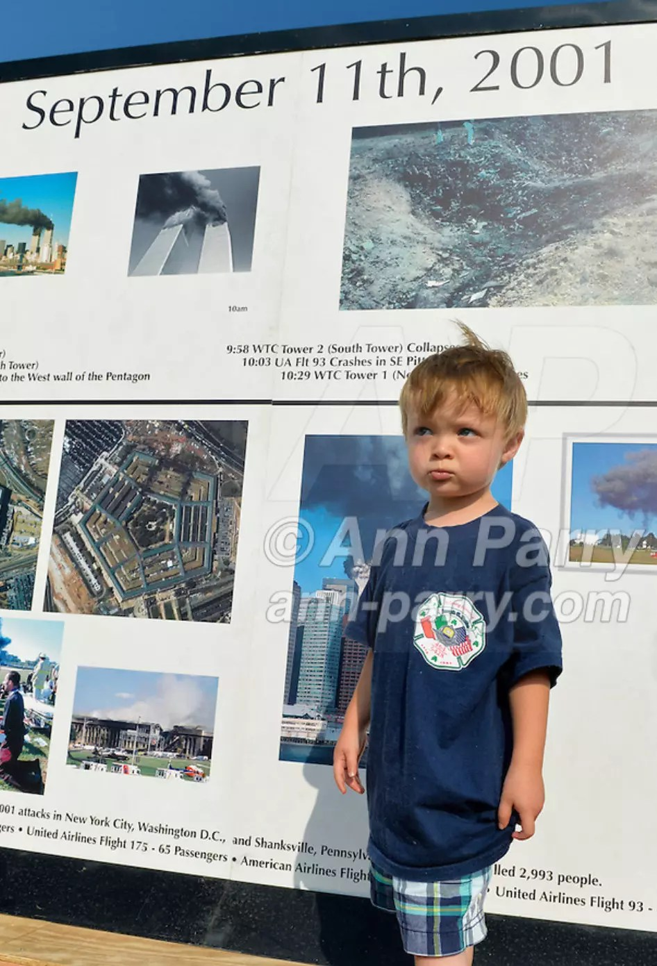 "East Meadow, NY, U.S. 11th Sept. 2013. TIMOTHY HUNTER, 3, of Wantagh, visits the Global War on Terror ""Wall of Remembrance"" a traveling memorial on display at Eisenhower Park on 12th Anniversary of the terrorist attacks of 9/11. Timothy's uncle Joseph G. Hunter, a firefighter in Squad 288 in Maspeth Queens, died during September 11th 2001 terrorist attack."
