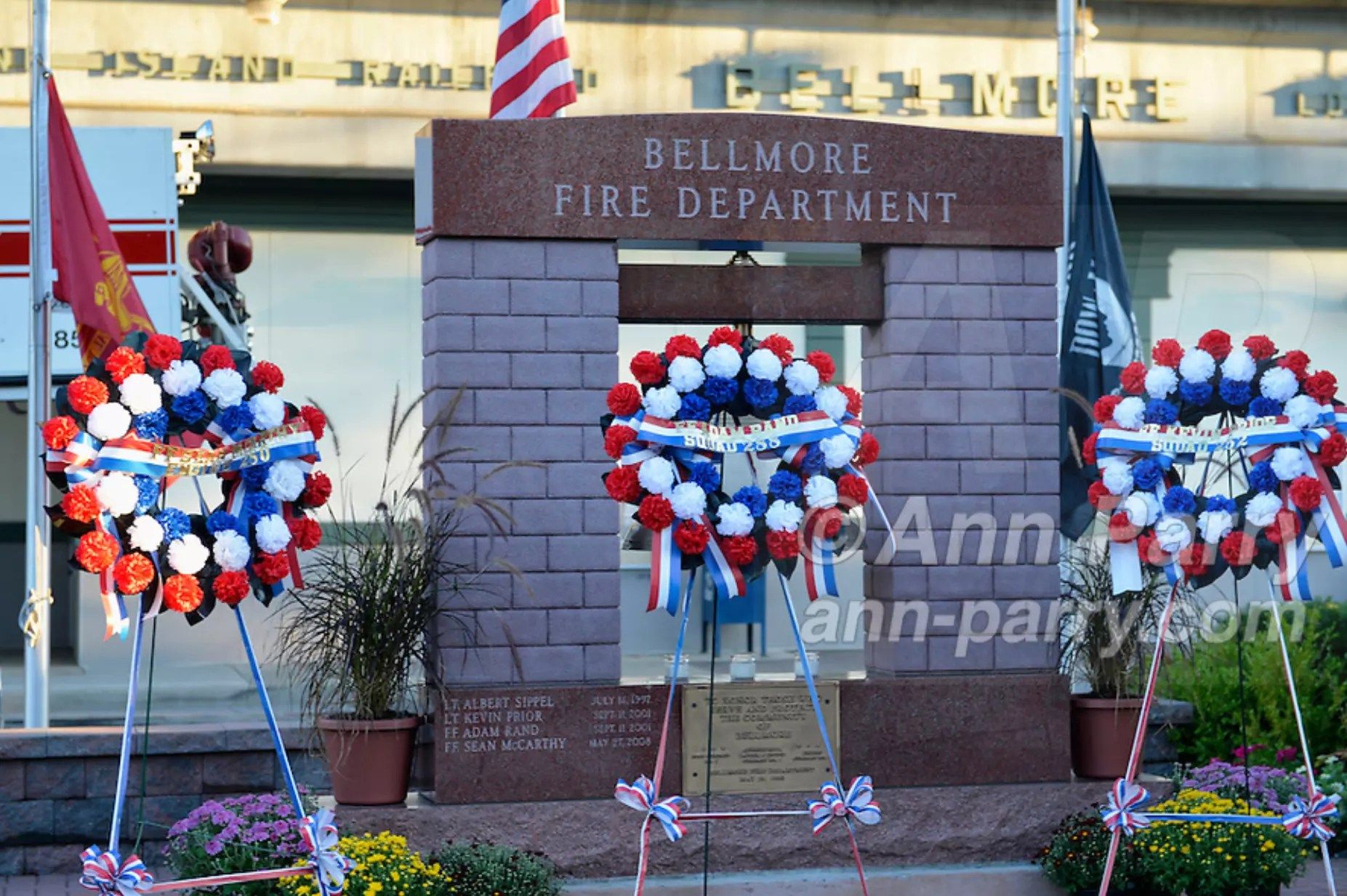 Bellmore, NY, USA. Sept. 11, 2015. At Bellmore Memorial Ceremony for 3 Bellmore volunteer firefighters and 7 residents who died due to 9/11 terrorist attack at NYC Twin Towers, a wreath is placed for each firefighter lost. Bellmore volunteer firefighters Lt. Kevin Prior and F.F. Adam Rand died on 9/11/2001, and F.F. Sean McCarthy died in 2008 due to illness related to working at scene of attack.
