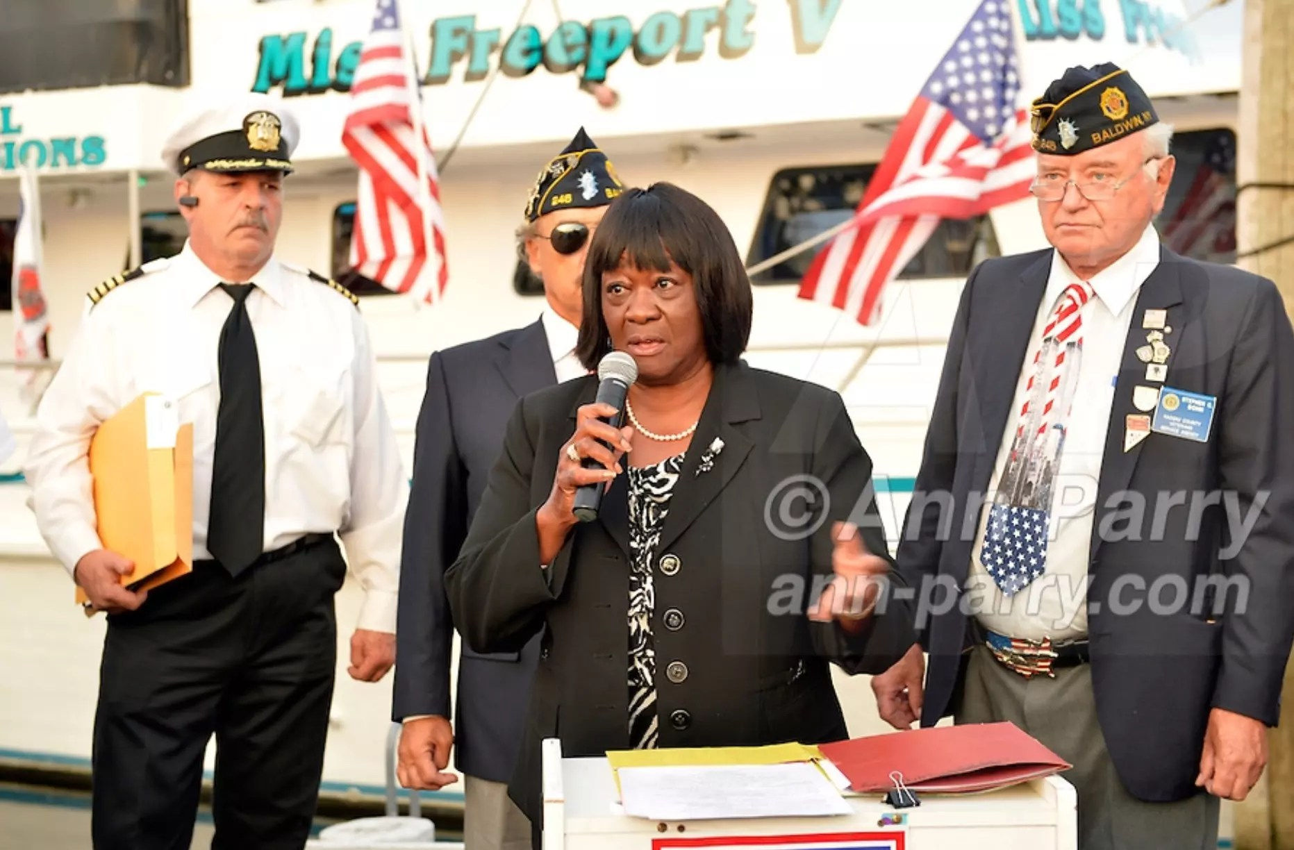 Freeport, New York, USA. September 10, 2014. DOROTHY GOOSBY, Town of Hempstead Councilwoman, speaks at a dockside remembrance ceremony in honor of victims of the terrorist attacks of September 11 2001, at the boat Miss Freeport V, on Freeport's Nautical Mile. Further ceremonies were held on board the vessel, which sailed from the Woodcleft Canal on the South Shore of Long Island, on the eve of the 13th Anniversary of the 9/11 attacks.