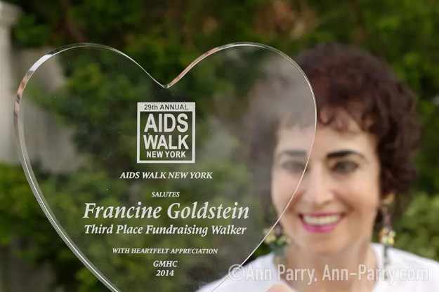 Merrick, New York, USA. May 3, 2018. Francine Goldstein poses with one of many appreciation trophies she's received from AIDS WALK NEW YORK,a fundraising walk and run in Central Park.(© 2018 Ann Parry/Ann-Parry.com)