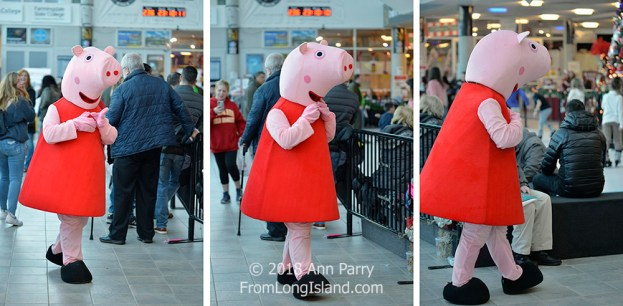 Garden City, NY, USA. Nov. 24, 2018. Peppa Pig walks in atrium of Long Island Festival of Trees holiday event, an annual family fun at the Cradle of Aviation Museum on Long Island. All proceeds raised benefit the non-profit charity Cerebral Palsy Association of Nassau County, Inc.