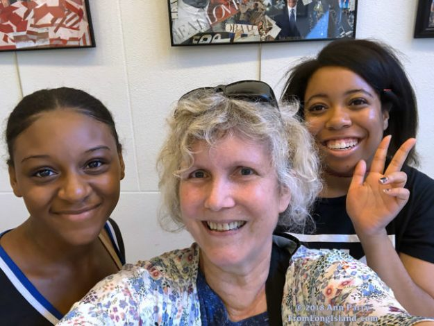 Freeport, New York, U.S. August 14, 2018. Trio with same birthday take selfie in lobby of Freeport Memorial Library, on Long Island. (2018 Ann Parry, AnnParry.com