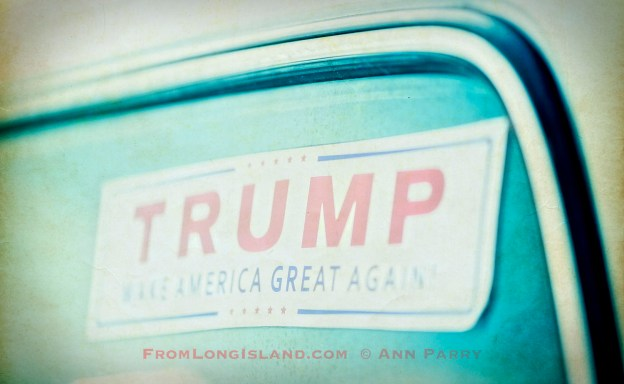 Bellmore, New York, USA. August 11, 2017. At the Bellmore Friday Night Car Show, a Trump Make American Great Again sticker is in rear windshield of a white pickup truck.