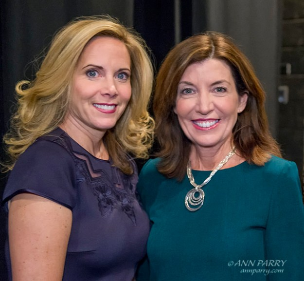 """Hempstead, New York, USA. January 1, 2018. L-R, Hempstead Town Supervisor LAURA GILLEN and New York State Lt. Governor KATHY HOCHUL pose for photo shortly before Lt. Gov. swears-in Gillen, at Hofstra University. (© 2018 Ann Parry/AnnParry.com)"