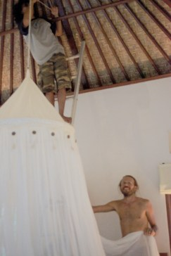 Putting up the mosquito net