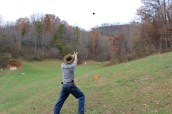 Jonathan did actually hit a clay pigeon with his pistol.