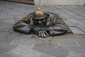 Sculptures in Bratislava - Who looks out of the drain?