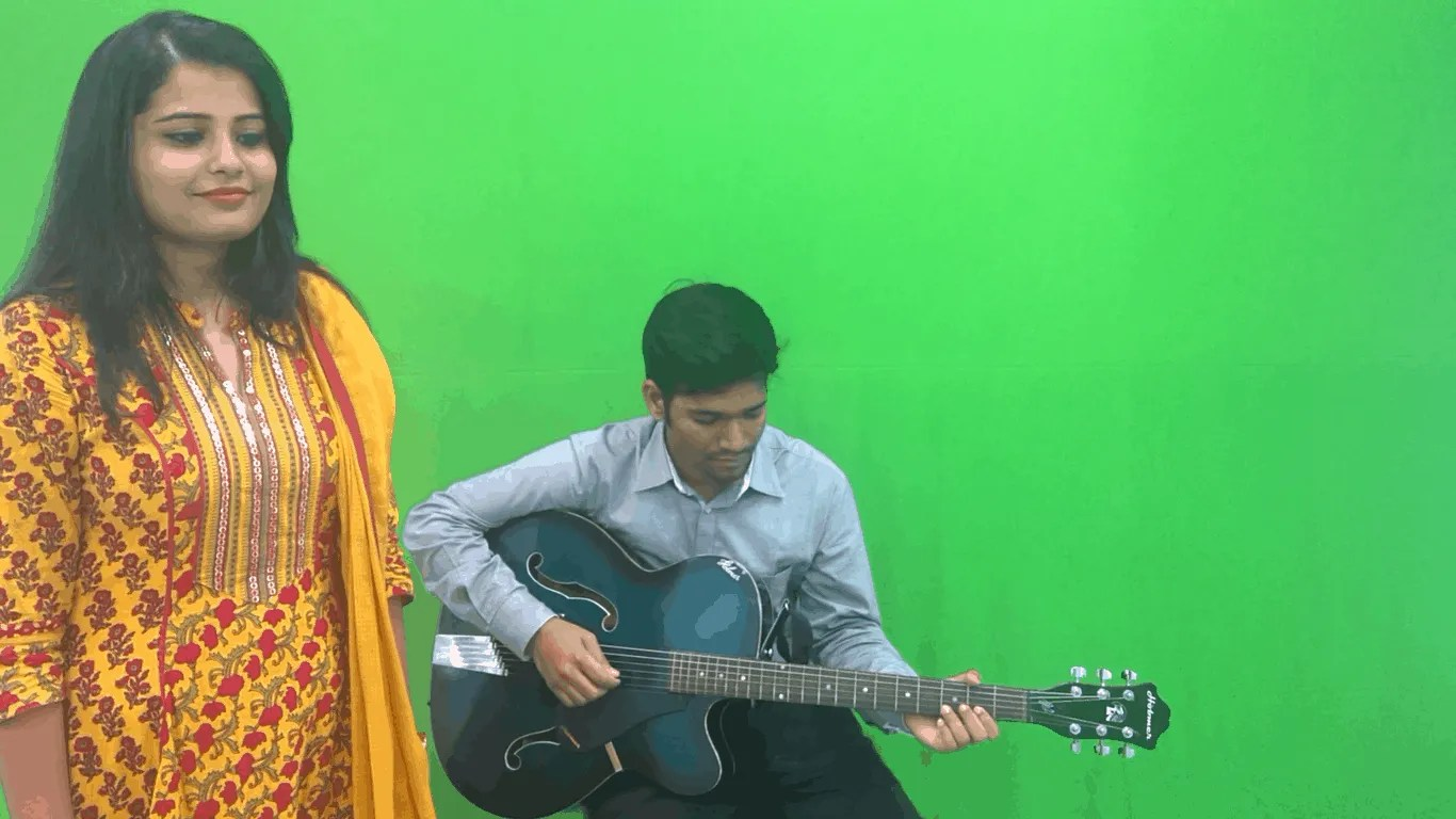 green screen background with a singer and a guitarist
