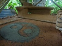 the cob bench and the yin-yang decorative symbol in grey clay
