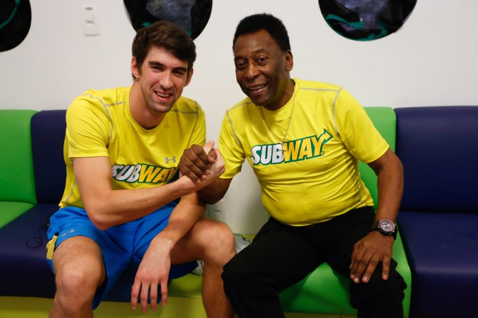SAO PAULO, BRAZIL - DECEMBER 04: Olympic swimmer Michael Phelps and Pele (L) attend a Subway press conference to promote healthy living and lifestyle among children on December 04, 2013 in Sao Paulo, Brazil. (Photo by Rafael Neddermeyer/Getty Images)