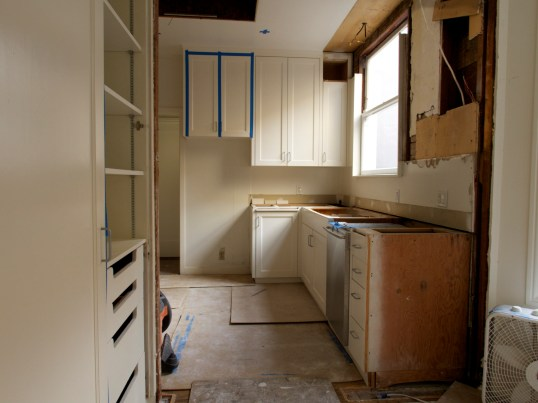 Pantry Looking Into Kitchen with Fridge, Countertops, Sink and Wall Removed, Day Two