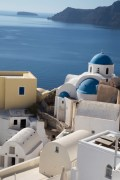 Santorini shapes and colors set against the blue of the caldera