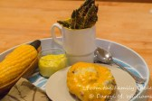 Corn-on-the-cob and twice-baked potato complete the meal