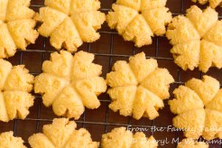 Cheddar cheese blossoms cooling on a baking rack