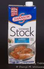 Seafood stock, vegetable stock, clam juice, or chicken stock will all work