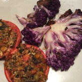 """Grilled cauliflower """"steaks"""" with roasted stuffed tomatoes"""