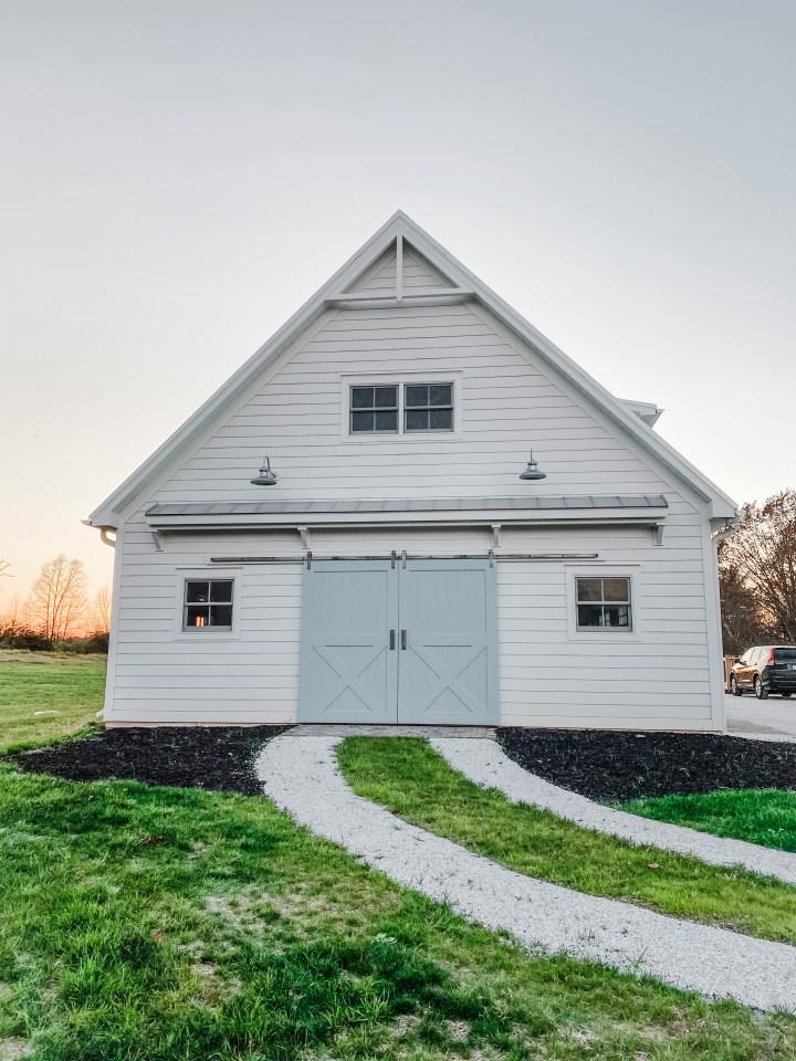 white barn garage with blue doors