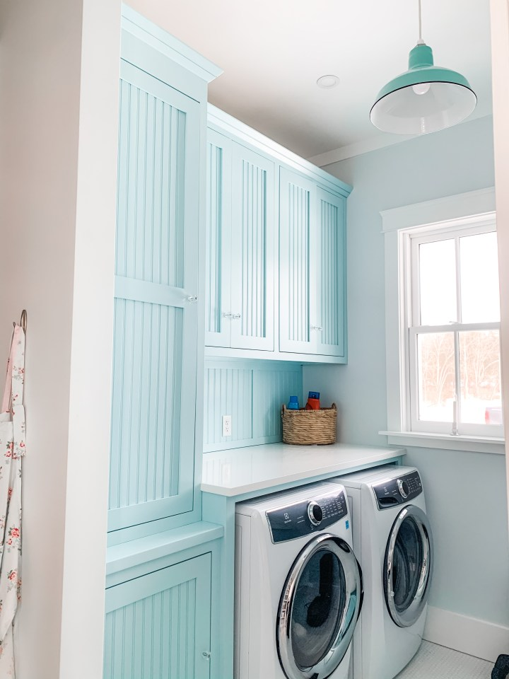 blue laundry room cabinetry