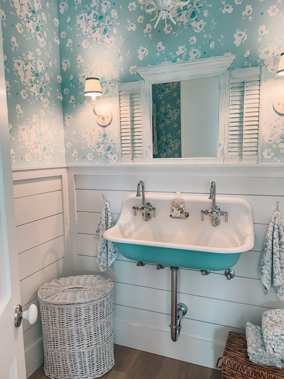 blue powder room in a four gables house plan