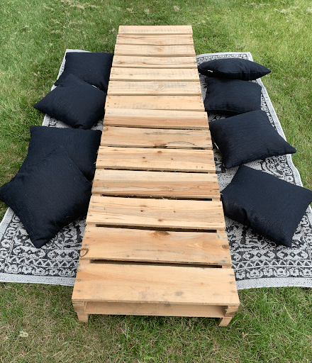 wood pallets and pillows for a picnic party