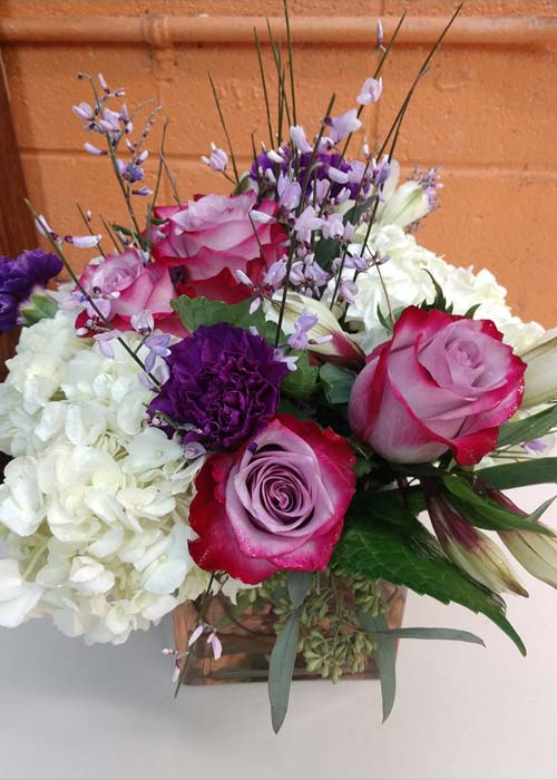 Compact Cube Or Round Vase Filled With Hydrangeas Roses Carnations Fillers Bouquet