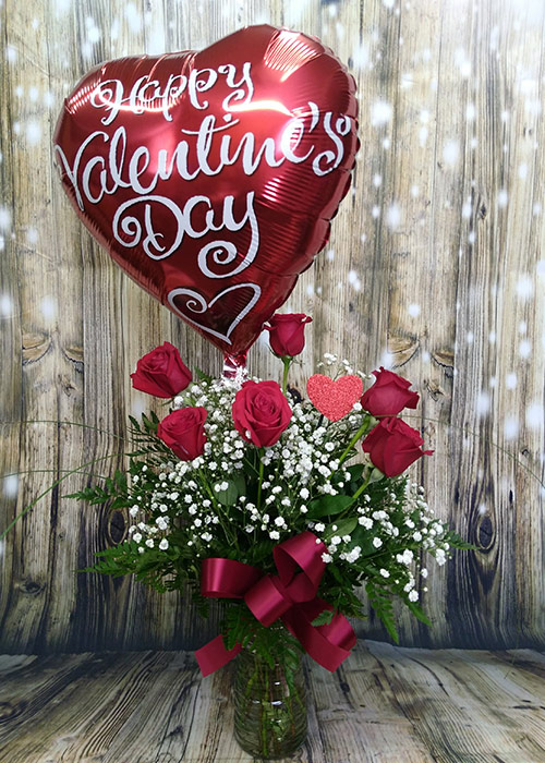 Valentine's day bouquet of a half dozen red roses with a mylar balloon. From the Heart Florist.
