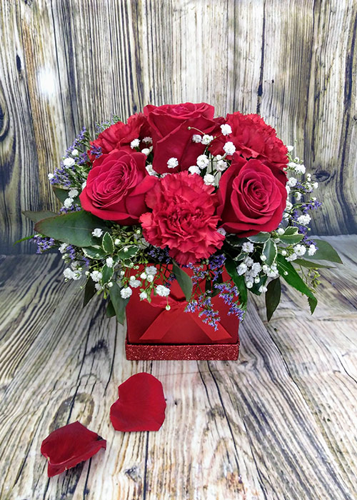 Valentine's Day bouquet of three red roses and three carnations in a beautiful red box. From the Heart Florist