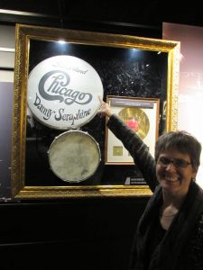 Janet pointing to Slingerland drum head of Chicago drummer Danny Seraphine
