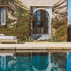 Palazzo Daniele, a new luxury guesthouse in Puglia with a black pool. 9 suites in a renovated palazzo with a focus on art.