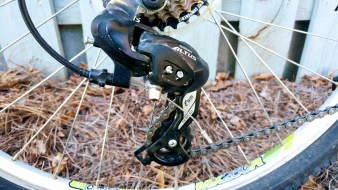 Rear derailleur: this works with the cassette to move the chain onto the appropriate gear controlled by the right shifter.