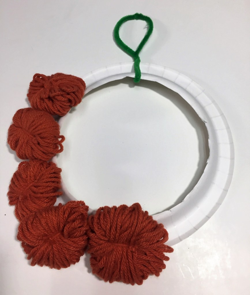 Diy Yarn Pumpkin Wreath by From Under a Palm Tree