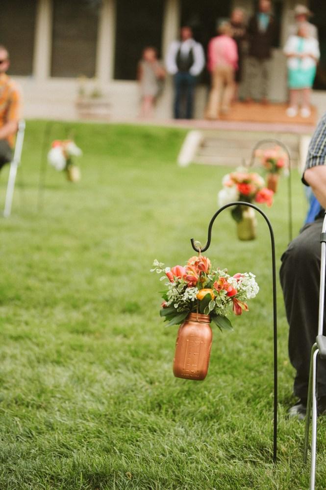 Wedding aisle shepherds hook mason jar bouquets rose gold