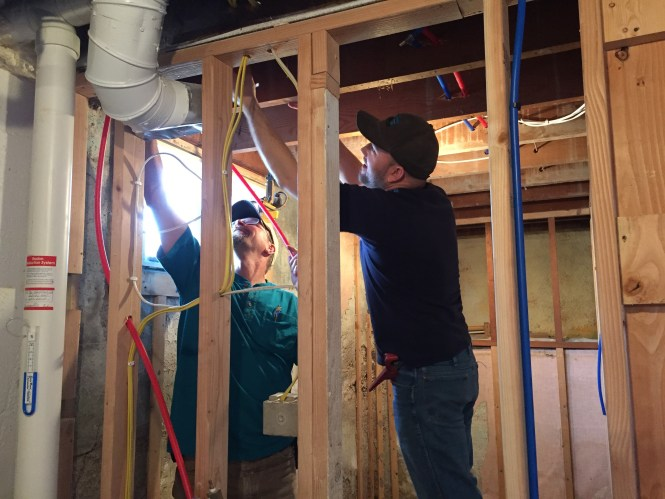 Jesse and Kerry installing PEX water piping