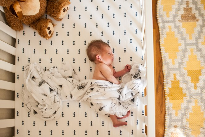 1 week old Henry James in crib Cheyenne WY newborn photography Kimberly + Scott